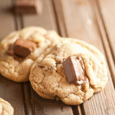 A close up of a couple of cookies with kit kat bars in it.