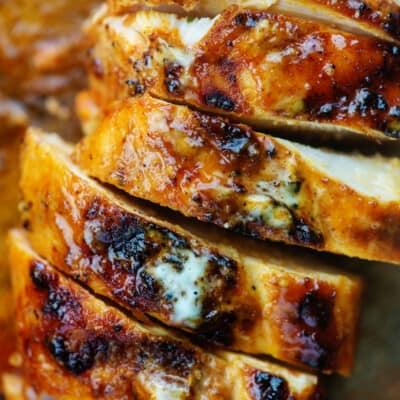 alabama white grilled chicken on cutting board.