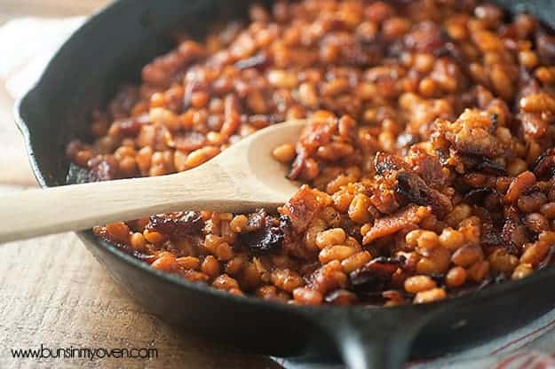 A tasty twist on traditional baked beans, perfect for summer barbecues! #mango #barbecue #summer #recipe