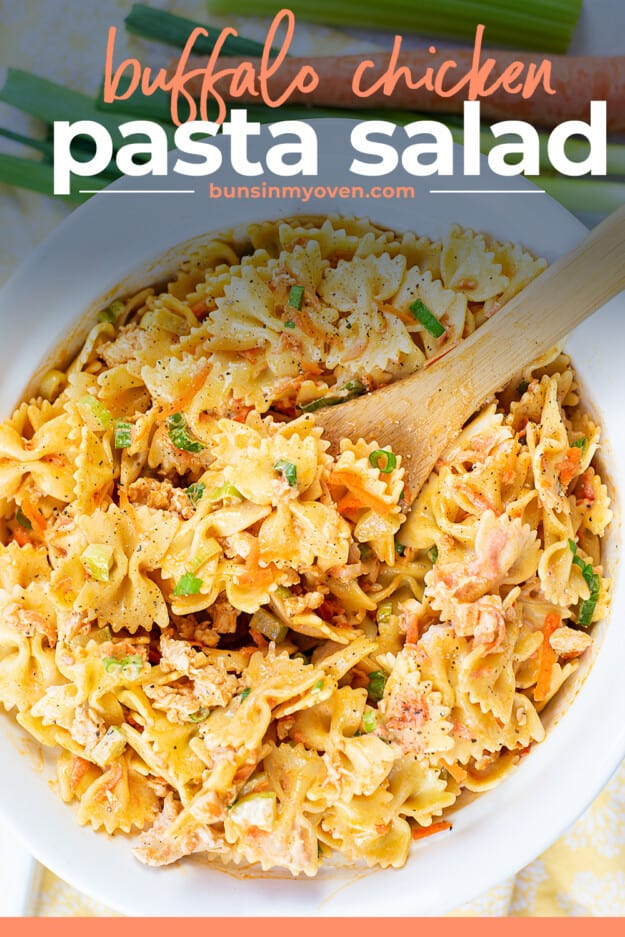 pasta salad with buffalo sauce in white bowl.