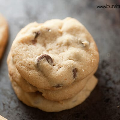 A close up of three stacked up shortbread cookies.
