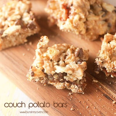 A close up of couch potato bar squares on a wooden cutting board.
