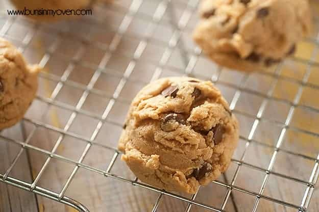 Almond butter chocolate chip cookies on a wire cooling rack.