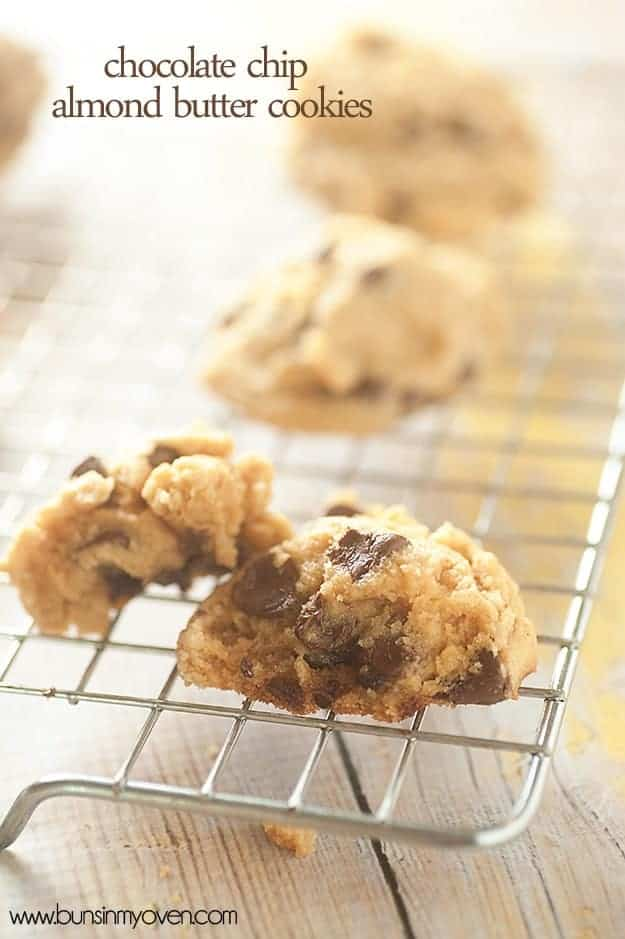 A chocolate chip cookie cut in half on a wire cooling rack.