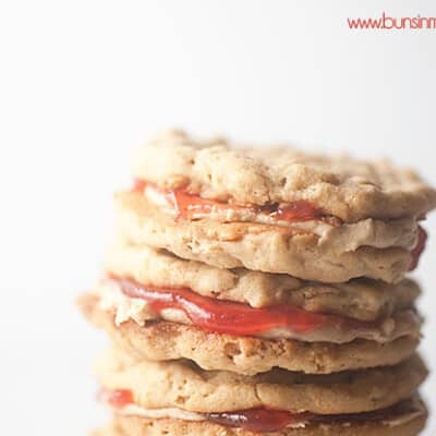 Peanut butter and jelly cookies stacked up.