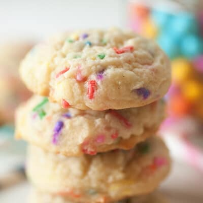 A close up of stacked confetti sugar cookies.