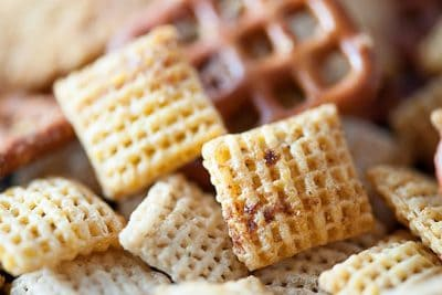 A close up of seasoned Chex cereal.
