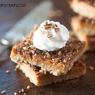 Pecan oatmeal bars stacked on a table.