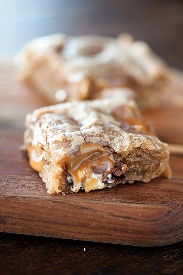 A close up of an apple blondie on a wooden cutting board.