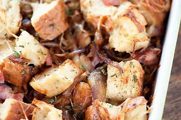 A close up of bread chunks and caramelized onions.
