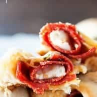 These homemade pizza rolls are stuffed with pepperoni and mozzarella cheese for a quick lunch or easy snack!