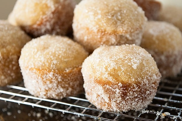 Easy baked donut muffins filled with applesauce for a perfect fall breakfast!