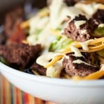A close up of a bowl of cheeseburger salad.