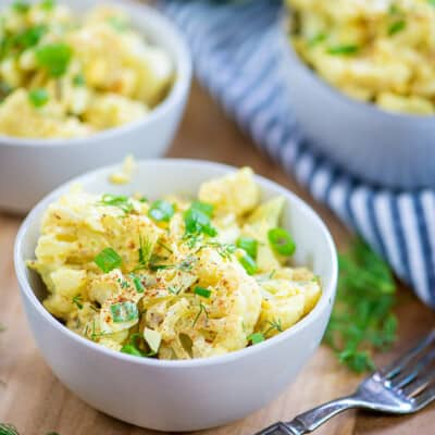 keto potato salad in small bowls.
