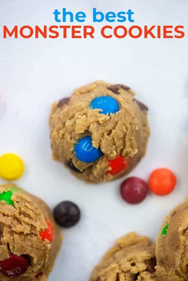 Monster cookie on white background with M&M's scattered