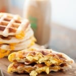 We love these biscuit waffles! They're stuffed with cheesy scrambled egg for an easy breakfast recipe!