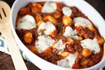 A plate of gnocchi casserole with melted cheese on top.
