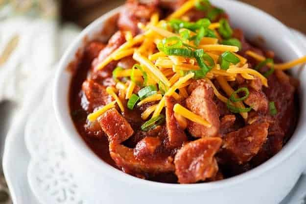 A simple homemade chili recipe that's made in the slow cooker and loaded with pulled pork!