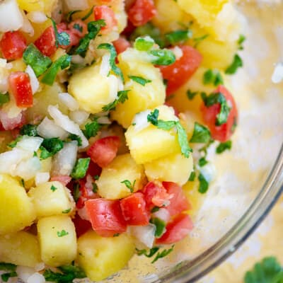 potato salad with pico de gallo in glass bowl.