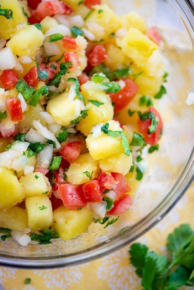 potato salad with pico de gallo in glass bowl.