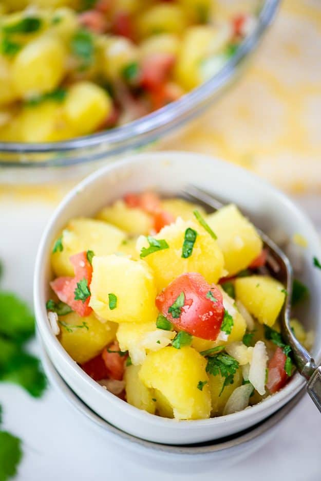 Mexican potato salad in white bowl.