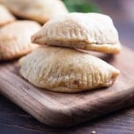 These carnitas empanadas are the perfect handheld snack or dinner recipe! They're loaded with rich carnitas and dipped in an easy avocado crema!