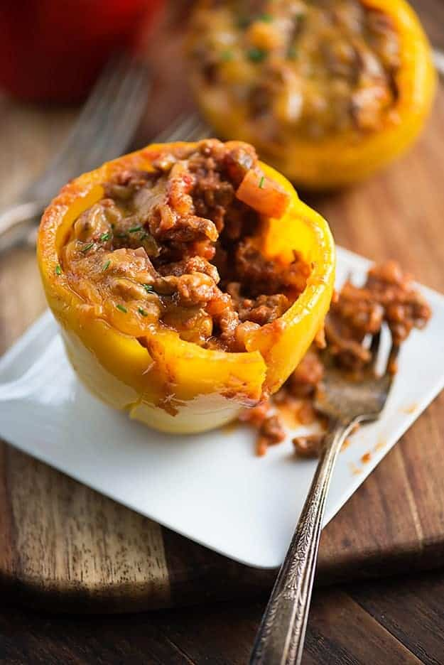 A stuffed pepper on a white plate with a fork.