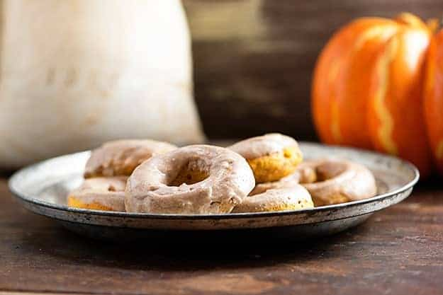 Baked pumpkin donuts with browned butter glaze! These easy donuts are full of pumpkin and topped with an amazing glaze!