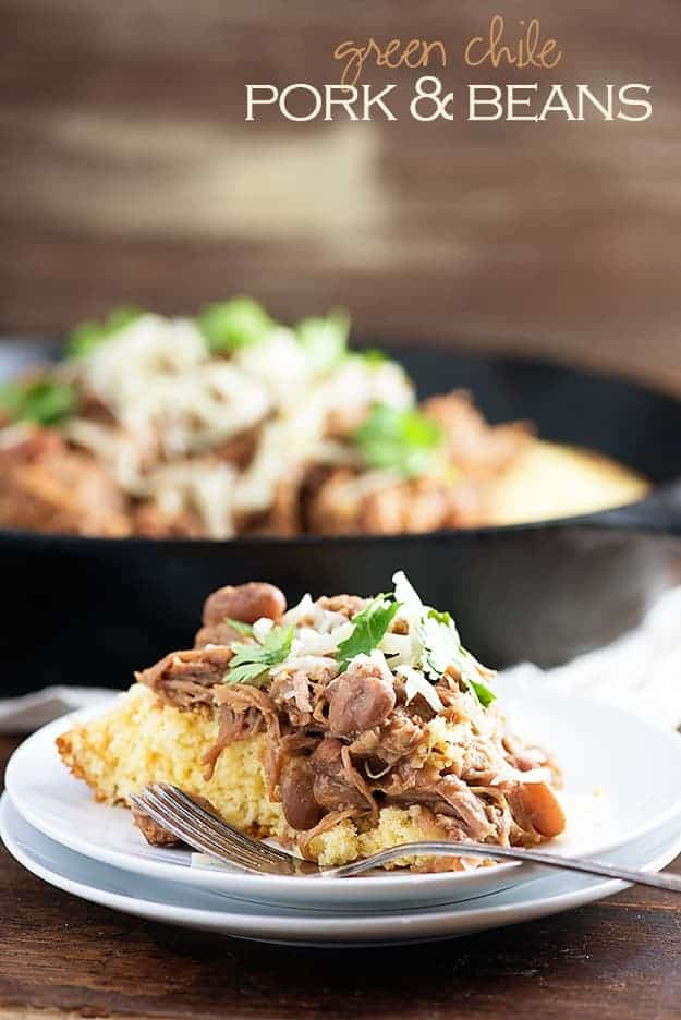 Slow cooker pork and beans! This is a cheap and easy slow cooker dinner that's perfect over cornbread. We love this for Mexican night!