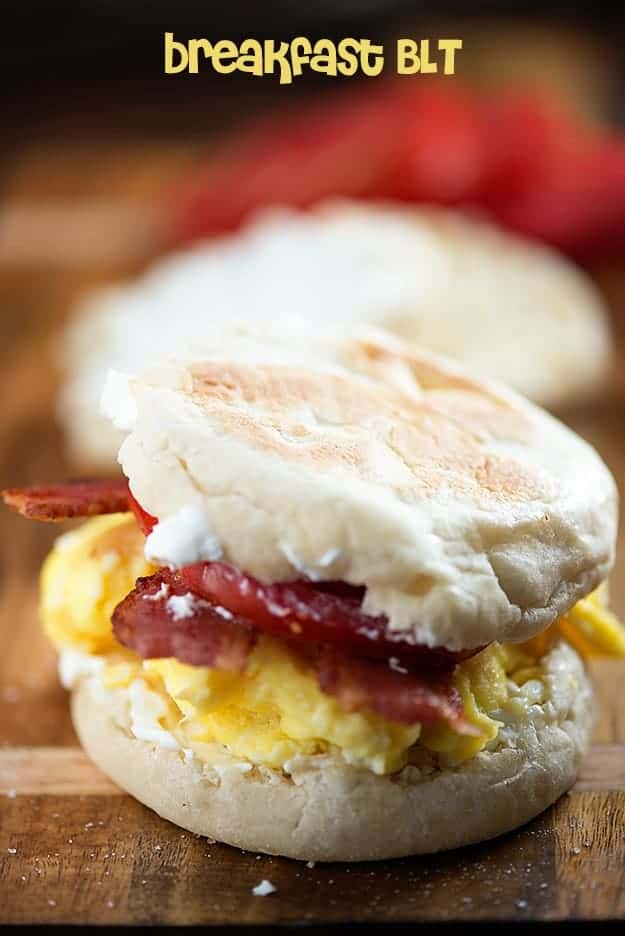 A close up of a biscuit with eggs and bacon in it
