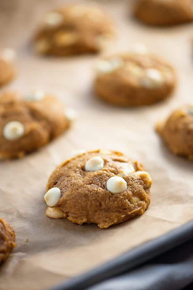 Chocolate chip pumpkin cookies on baking sheet