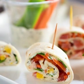 These tortilla roll ups are loaded with creamy dill dip and fresh vegetables! They're an easy appetizer for your next party or a great healthy snack!
