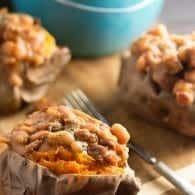 These crock pot baked beans are loaded with diced ham! Serve them over baked sweet potatoes for an easy dinner!