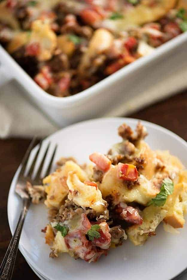 Mexican Breakfast Casserole - loaded with bagels, cheese, sausage, and tomatoes with chiles! Such an easy, cheesy way to get breakfast on the table!