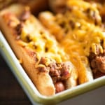 Oven Baked Sloppy Joe Dogs! They're cheesy and messy - perfect for a quick lunch or to feed the fans at the next football game!