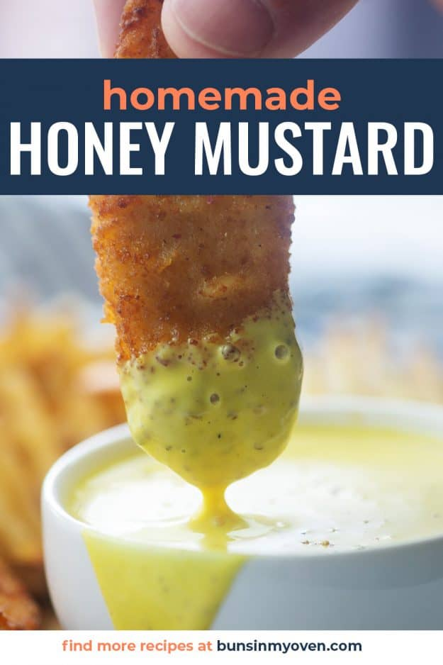 homemade honey mustard dressing in white bowl with a chicken strip
