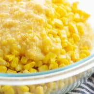 corn casserole ingredients in glass mixing bowl.