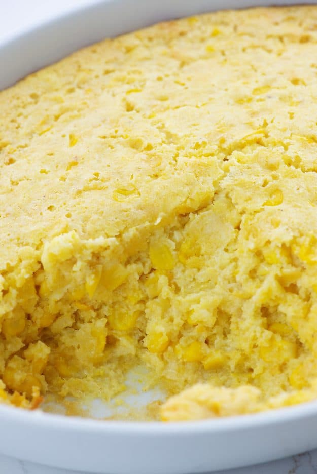 Jiffy corn casserole in white baking dish.