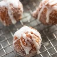 Simple donuts tossed in cinnamon and sugar and drizzled with a sweet and sticky glaze!