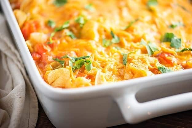 This King Ranch Casserole is packed with chicken, Ro*Tel, plenty of cheese, and corn tortillas. It's one of our favorite Mexican casserole recipes!