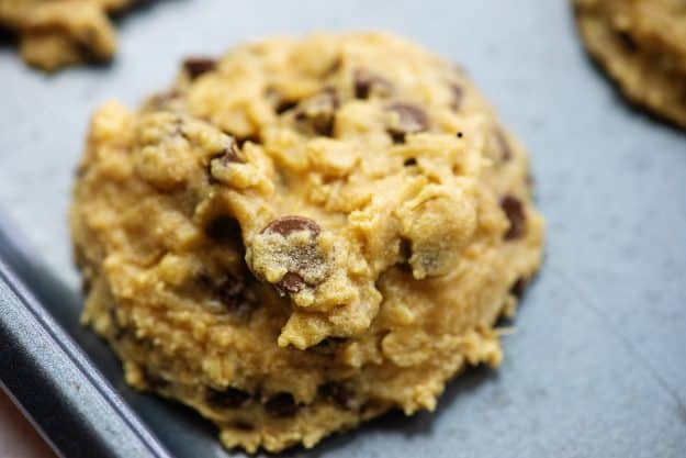 thick and chewy peanut butter cookies with oatmeal and chocolate chips on baking sheet
