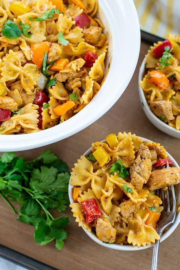 overhead view of chicken fajita pasta in bowls.