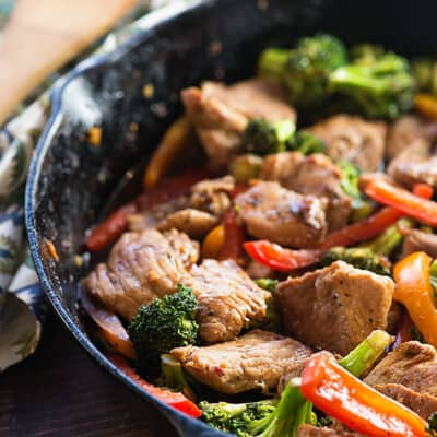 A cast-iron skillet cooking stir fry.