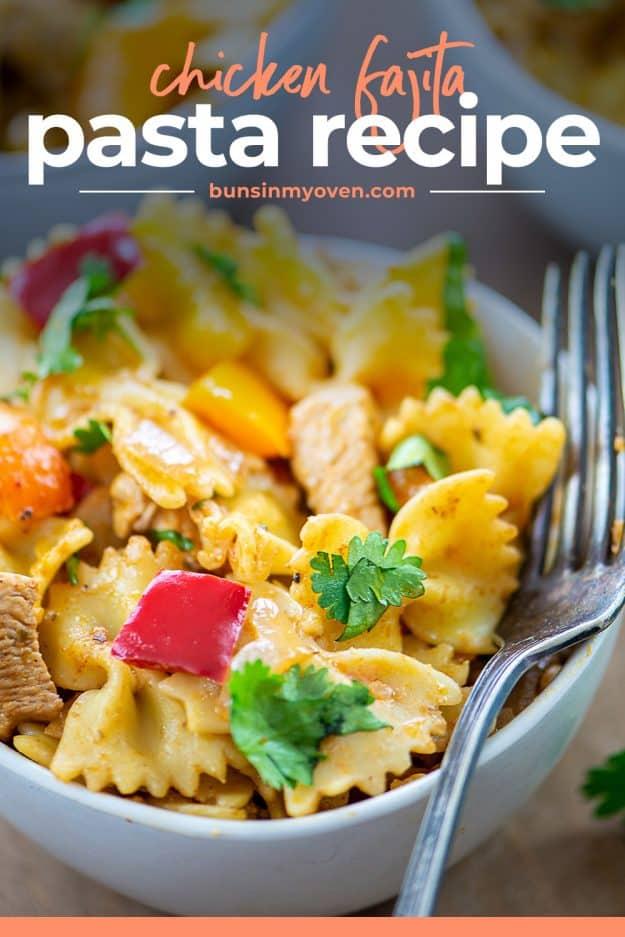 chicken fajita pasta in white bowl with fork.