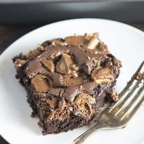 Just 4 ingredients in this chocolate peanut butter dump cake! You dump 'em in a bowl,l stir, and bake!