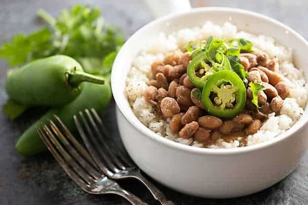 Tex-Mex pinto beans in the pressure cooker! These Instant Pot pinto beans are done so much faster than traditional beans!