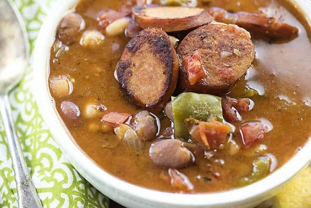A bowl sausage and bean soup.