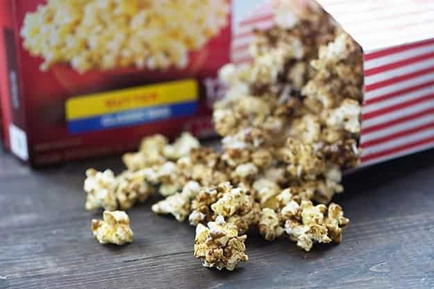 This pumpkin spice caramel corn is made easy in the microwave! It's the perfect sweet treat to munch on while binge watching your favorite tv show!