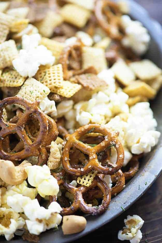 This snack mix is all mixed up with my favorite flavor - dill pickles! You'll love the dill pickle cashews with the crunchy cereal, pretzels, and popcorn!