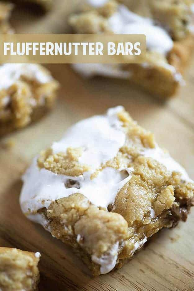 A close up of a fluffernutter bar on a cutting board.